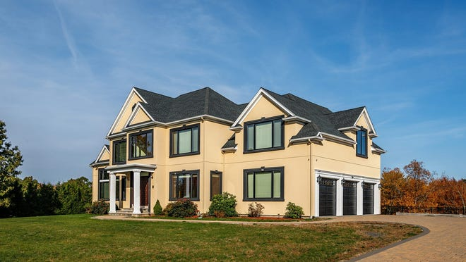 This 5,075-square-foot contemporary in Orchard Hill Estates in Westborough offers 10-foot ceilings, floating staircases and a chef's kitchen.