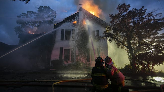 West Bridgewater, East Bridgewater, Bridgewater, Easton, Whitman, Halifax and Raynham fire departments battle a 2-alarm house fire at 35 East Center Street in West Bridgewater on Wednesday, Sept. 23, 2020.