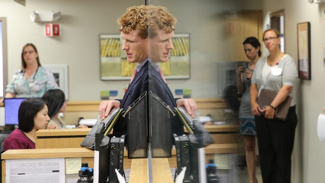 Congressman Joe Kennedy III, D-4th, speaks with staff at the Edward M. Kennedy Community Health Center, named in honor of his great uncle, in Milford in 2018.
