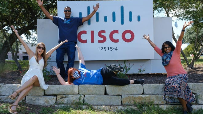 From left, employees Wendy Howell, Quincy Hopkins, Stephanie Mosher and Prasanthi Somepalli pose in front of a Cisco Systems sign in Austin. Cisco is the No. 2-ranked larged employer in the American-Statesman's 2020 Top Workplaces of Greater Austin project.