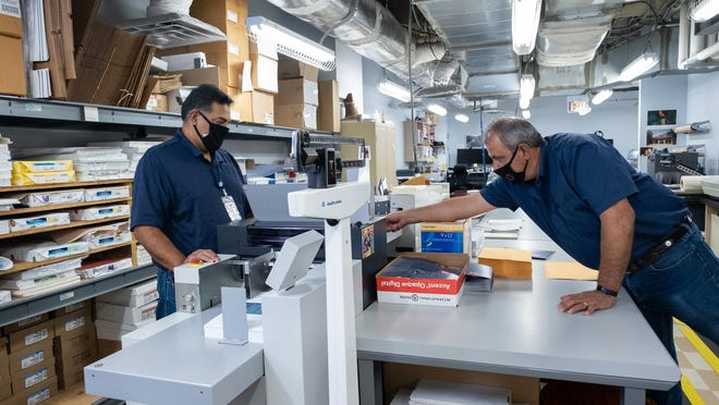 Dirk Ruedas and Raul Martinez work together in the print services department at the Texas Association of Counties' headquarters in Austin. The Texas Association of Counties is the No. 1-ranked midsized employer in the American-Statesman's 2020 Top Workplaces of Greater Austin project.