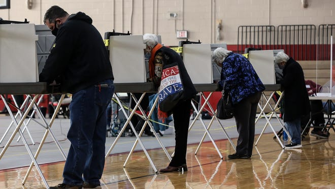 Residents fill out their ballots on Election Day at Holliston High School, Nov. 3, 2020.