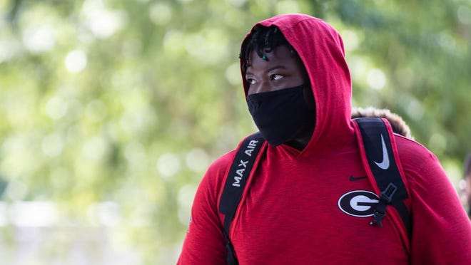 Georgia center Trey Hill walks to a workout session on Thursday, July 9, 2020, in Athens, Georgia.