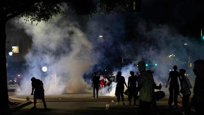 Tear gas is used to disperse protesters who had gathered to protest police brutality and the death of George Floyd, a black man who died in police custody in Minneapolis, on Sunday, May 31, 2020, in downtown Athens, Georgia.