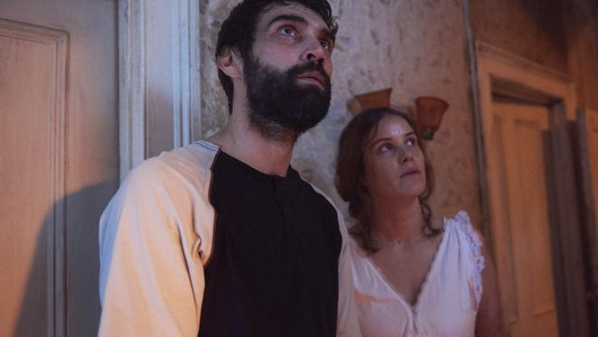 "(L-R) Alec Secareanu and Carla Juri star in Romola Garai's ""Amulet,"" opening Friday at athenscine.com"