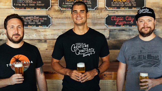 (L-R) Creature Comforts Brewing Co. founders David Stein, Chris Herron, and Adam Beauchamp are pictured in this undated promotional image. On August 11, 2020, the Athens, Ga.-based brewery announced plans to expand their operation to Los Angeles, Calif.
