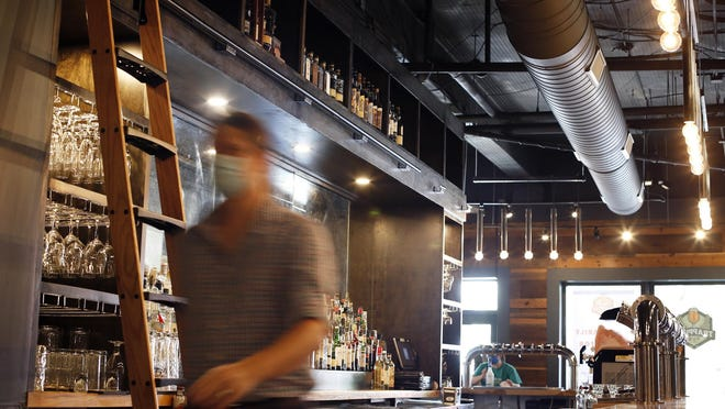 Staff prepare the Trappeze Pub to reopen in downtown Athens, Ga, on Friday, Sept. 4, 2020.