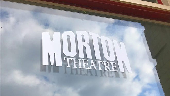 This photo taken September 23, 2020 shows one of the front windows of the historic Morton Theatre in Athens, Georgia.