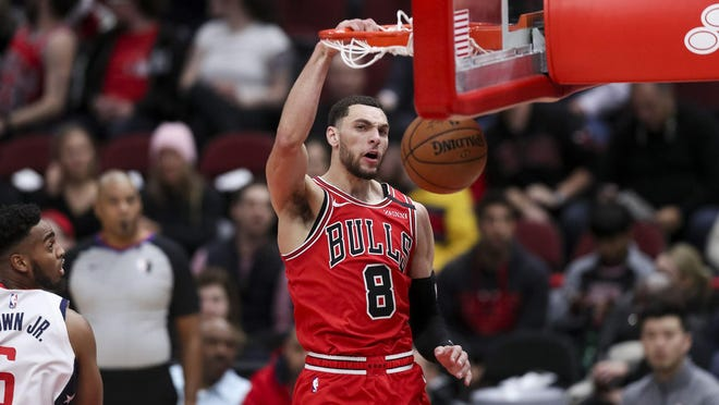 The Chicago Bulls' Zach LaVine dunks against the Washington Wizards at the United Center in Chicago on January 15, 2020.