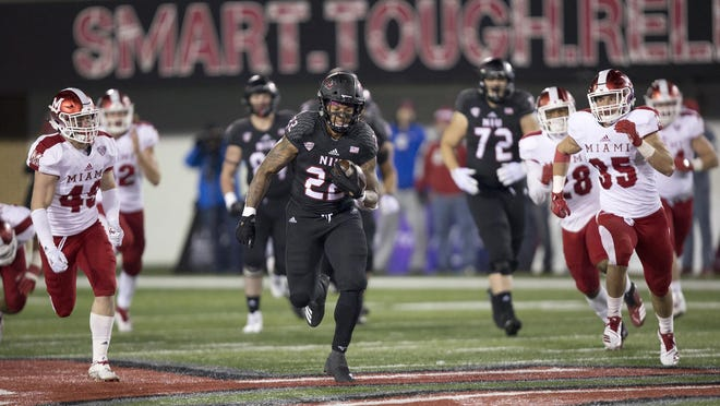 The Northern Illinois University Huskies will play football this fall after all. The Mid-American Conference decided Friday to play a six-game season starting Nov. 4. Former NIU running back Tre Harbison, center, is shown here running the ball against Miami of Ohio.