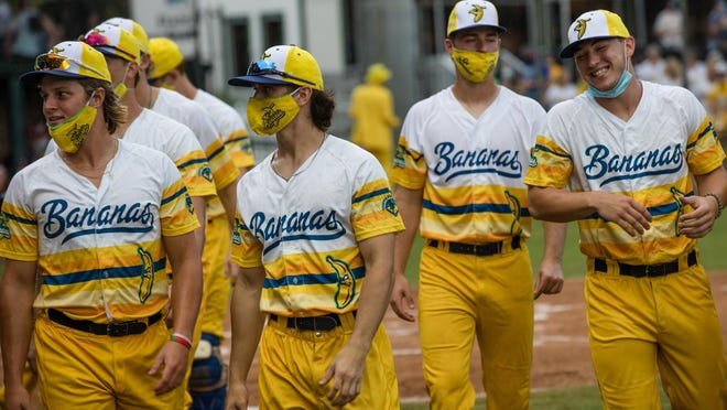 The Savannah Bananas' Garrett Bradley (second from left) walks out with the team before the start of a recent game at Grayson Stadium.