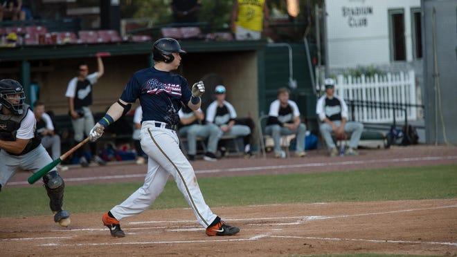 Savannah Bananas third baseman David Mendham follows through on a big swing during a recent game at Grayson Stadium.