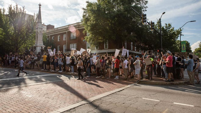 Demonstrators rally in downtown Athens on Thursday.