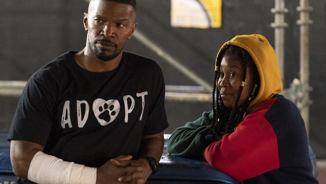 """(L-R) Jamie Foxx and Dominique Fishback appear in a scene from Netflix's """"Project Power."""""""