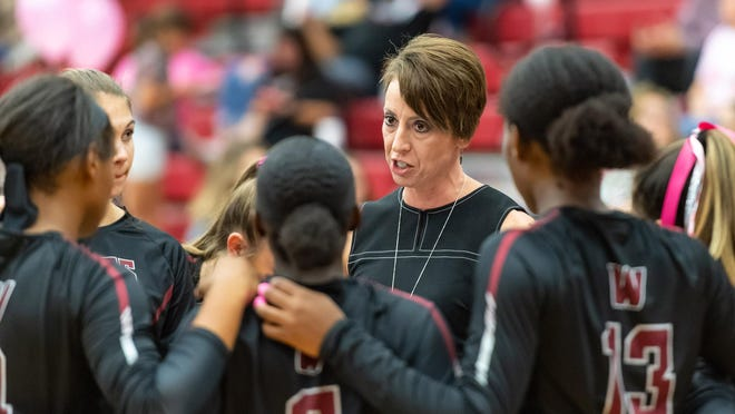 Weiss volleyball coach Karen Huffman guided the Wolves to their first playoff berth in the school's third year of varsity play.