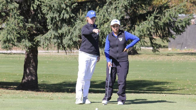 University of Dubuque assistant men's and women's golf coach Jordan Koehler, a 2015 Galesburg High School grad, talks strategy with senior Daniela Miranda (right) on Monday, Oct. 12, at the American Rivers Conference Championship in Ames, Iowa.