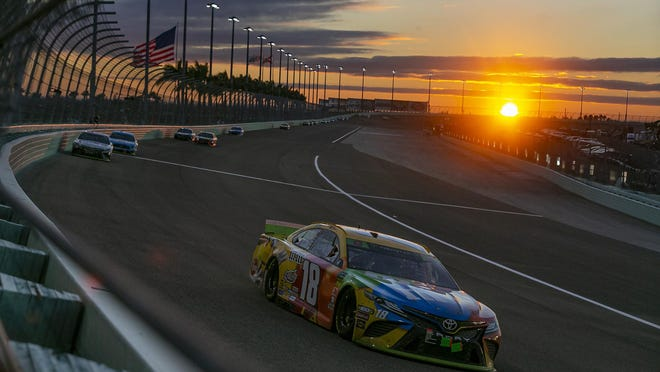 Kyle Busch (18) races at the Homestead-Miami Speedway on Sunday, Nov. 17, 2019 in Homestead, Fla. NASCAR will allow 1,000 spectators to attend this Sunday's race.