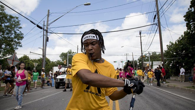 A member of the Austin All-Star Band leads the group during the annual Juneteenth parade on June 15, 2019, in Austin, Texas.  Juneteenth, also known as Juneteenth Independence Day,  is a holiday that commemorates the end of slavery in the United States.