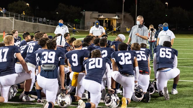 The Stony Point football team, listening to coach Craig Chessher following a victory over Bowie in October, will be forced to forfeit two games while the school closes its doors for two weeks over a COVID-19 scare at the school.