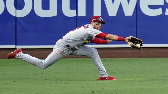 St. Louis Cardinals left fielder Dylan Carlson makes the catch for the out on San Diego Padres' Manny Machado during the seventh inning of Game 1 of a National League wild-card baseball series Wednesday, in San Diego.