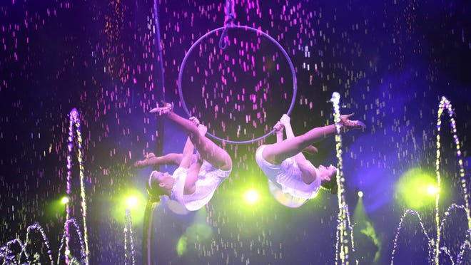 (L-R) Aerial lyra duo Roxa Midi and Susana Silva are among the Cirque Italia perfromers. The touring water circus opens Thursday at the Athens Fairgrounds in Winterville, Ga.