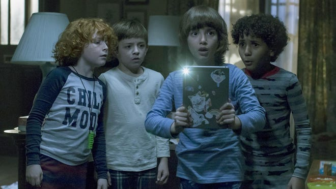 """(L to R) Gavin Maciver-Wright, Winslow Fegley, Azhy Robertson, and Jayden Marine star in """"Come Play."""""""