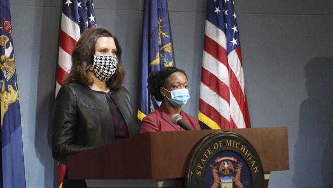 """In a pool photo provided by the Michigan Office of the Governor, Michigan Gov. Gretchen Whitmer, wearing a mask, addresses the state during a speech in Lansing, Mich., Friday, May 1, 2020. On Wednesday, Sept. 2, Whitmer said an announcement over the reopening of gyms and the potential resumption of fall high school football would be made """"very soon."""""""