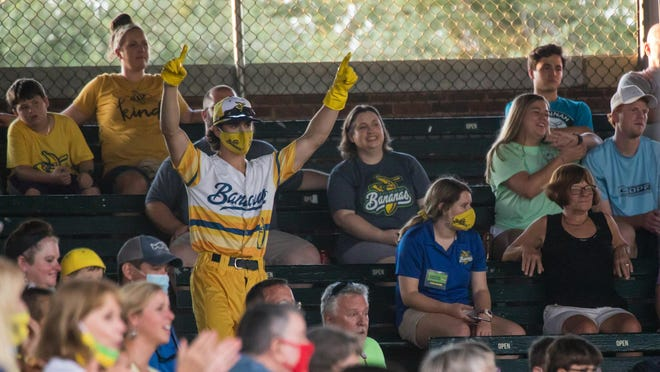 The Savannah Bananas' Garrett Bradley helps out in the stands between innings during a recent game at Grayson Stadium.