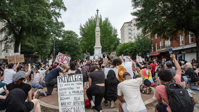 Demonstrators gather to protest police brutality and racial injustice on June 6, 2020, around the Confederate monument downtown Athens, Georgia. Athens-Clarke officials have proposed a plan that would move the monument to a Civil War battle site.