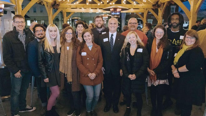 Get Artistic Program Lead, Madeline Bates (left of center), at the December 2019 Get Artistic wrap-up event with 2019 grant recipients: Athens Area Arts Council, Athens Symphony Orchestra, Canopy Studio, Abigail West, Broderick Flanigan, and tinyATH Gallery.