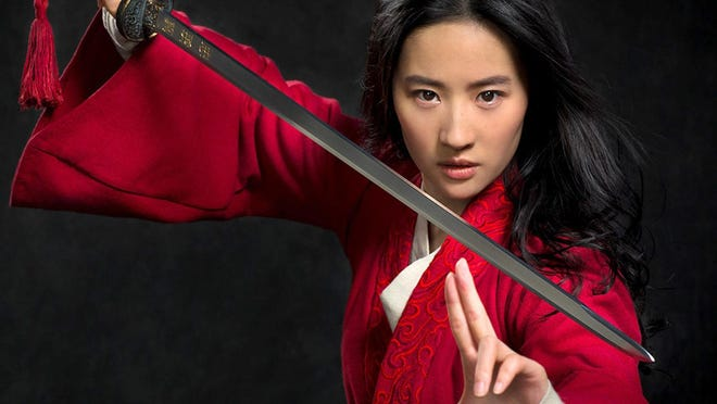 "Yifei Liu appears in a promotional photo for ""Mulan."" Originally set to come out in March, Disney has since moved the release date twice."