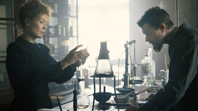 "This image released by Amazon shows Rosamund Pike as Marie Curie, left, and Sam Riley as Pierre Curie in a scene from ""Radioactive."""