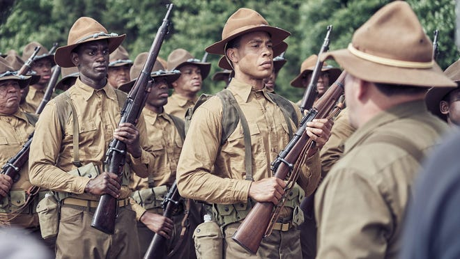 "Trai Byers (center) stars as ""Boston"" in the World War I drama, ""The 24th,"" filmed in North Carolina."