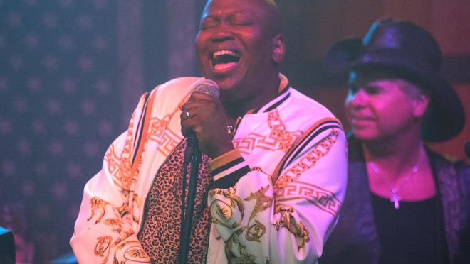 "Tituss Burgess appears in a scene from ""Unbreakable Kimmy Schmidt Vs. The Reverend."" Burgess will host the musical game show ""Sing On!"" starting September 16 on Netflix."