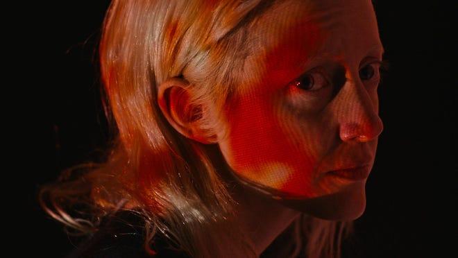 "Andrea Riseborough stars as corporate assassin Tasya Vos in Brandon Cronenberg's ""Posessor Uncut,"" opening Friday at Athens Ciné."