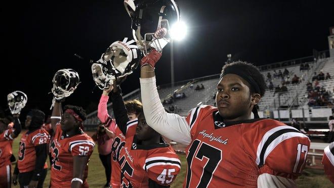 Hephzibah players raise their helmets during the opening kickoff at the high school football game between Harlem and Hephzibah in Hephzibah, GA, Friday, October, 10 2019. [MIKE ADAMS/SPECIAL] \r