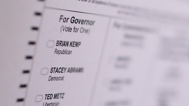 FILE - A sample ballot showing Georgia gubernatorial candidates Republican Brian Kemp, Democrat Stacey Abrams and Libertarian Ted Metz is displayed at Chase Street Elementary in Athens, Ga., Tuesday, Nov. 6, 2018.