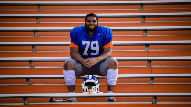 Savannah State University defensive lineman Kyle Frazier sits in the stands following practice at T.A. Wright Stadium. Frazier, who has overcome Hodgkins lymphoma, will be featured during the Monday Night football game featuring his favorite team, the L.A. Rams, on Oct. 26.