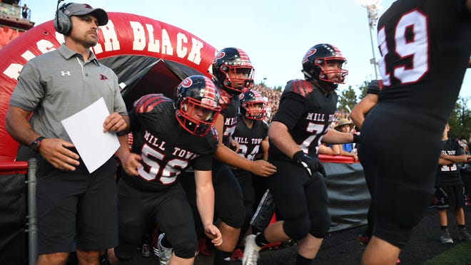 Pisgah head coach Brett Chappell and his team take the field back in 2018 when they hosted Tuscola for their rivalry football game.
