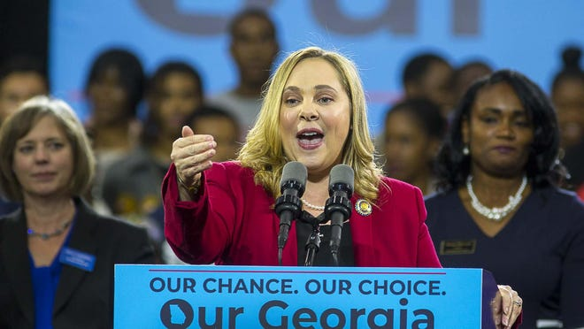 FILE - In a Friday, Nov. 2, 2018 file photo, Sarah Riggs Amico speaks during a rally for Democratic gubernatorial candidate Stacey Abrams, at Morehouse College in Atlanta. Business executive and 2018 candidate for lieutenant governor Sarah Riggs Amico announced her candidacy for the U.S. Senate Tuesday, August 27, 2019.