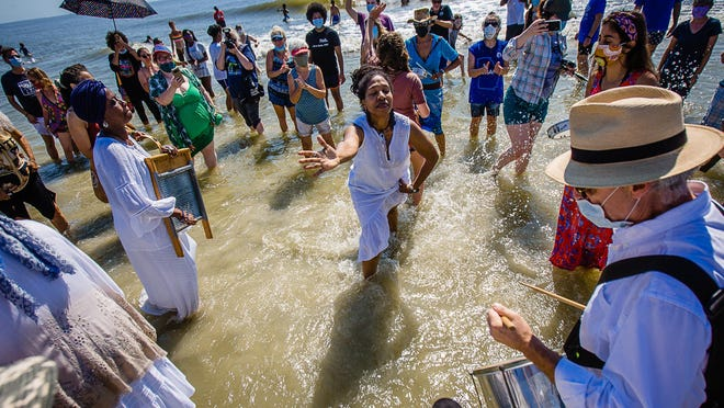 Participants dance in the ocean as they celebrate during the annual Juneteenth Wade In, Friday morning, June 19, 2020 on Tybee Island. Juneteenth is a celebration of the day Union soldiers reached Galveston, Texas, with the news that the war had ended and enslaved people were free.