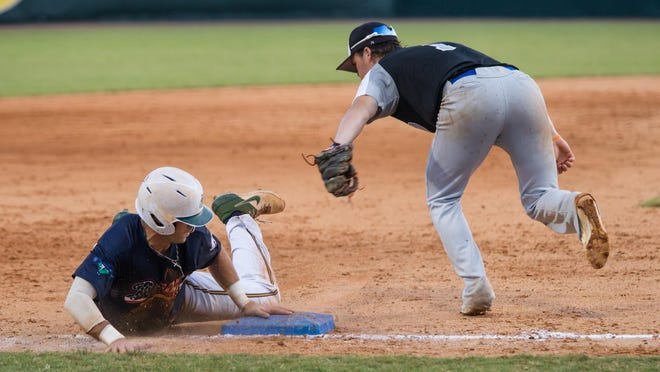 Savannah Bananas shortstop Gabe Howell slides safely into third with a stolen base during Friday night's game against the Catawba Valley Stars at Grayson Stadium.