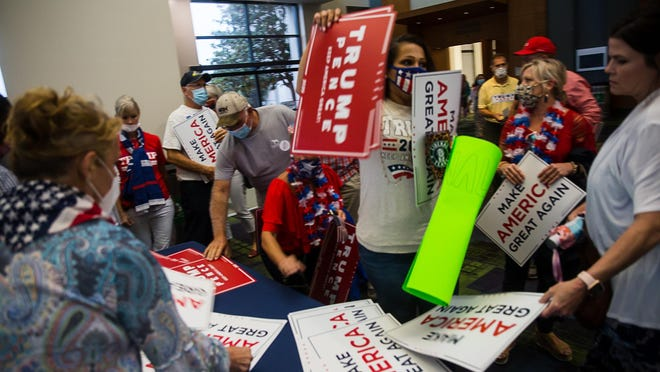 Trump supporters grab campaign signs following Donald Trump, Jr.'s speech Wednesday night at the Savannah Convention Center on Hutchinson Island.