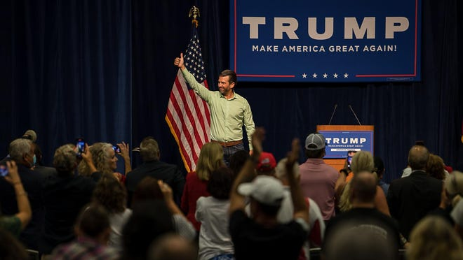 Donald Trump, Jr gives a big thumbs up to the crowd after speaking Wednesday night at the Savannah Convention Center.