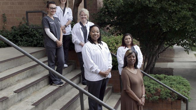 Medical assisting graduates are left to right (front row) Hannah Martin, Casey Elliott, Shelly Medrano, (back row) Amber McComas, Tamar Brintley and instructor Colette Hill.