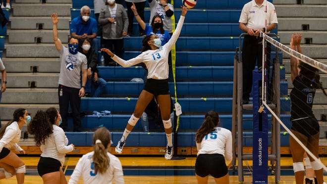 Ann Richards' Tiffiney Booe goes up for a shot during the Stars' first round playoff win over Pflugerville last week. Booe had 16 kills to the lead District 17-5A champion.