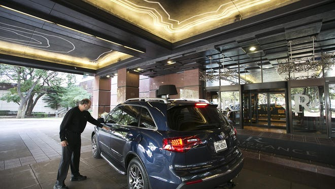 A Renaissance Austin Hotel employee greets an arriving customer in this photo from 2016. The hotel at 9721 Arboretum Blvd. has been sold to a California investment firm for $70 million.