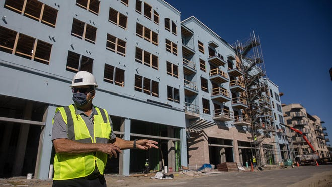 Trent Germano, co-founder of Mariner Group, gives a tour and update of the Eastern wharf project, including the Riverworks Apartment buildings where construction had to start over following a fire in February.