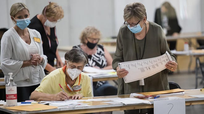 Chatham County poll workers count each ballot by hand during the presidential election audit.