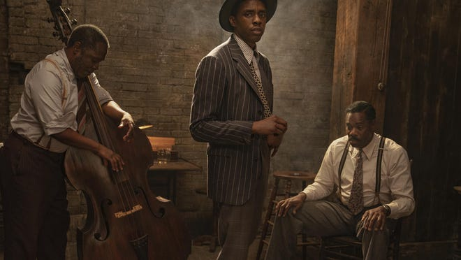 "This image released by Netflix shows Michael Potts, from left, Chadwick Boseman and Colman Domingo in ""Ma Rainey's Black Bottom."""